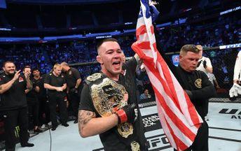 Колби Ковингтон с флагом США и поясом UFC
